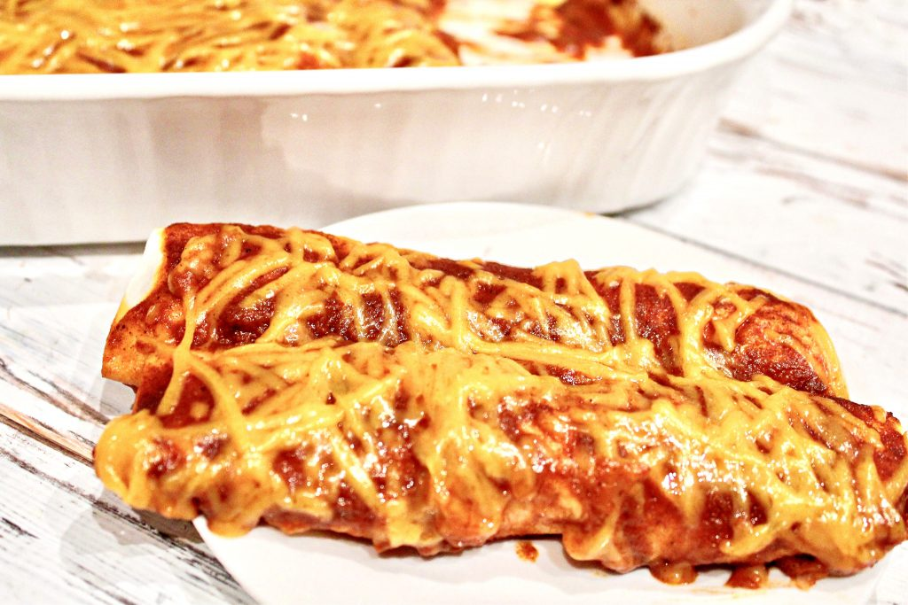 Beefy Bean and Cheese Vegan Enchiladas ~ These enchiladas are easy to make and perfect for feeding a crowd! Ready to serve in under an hour!