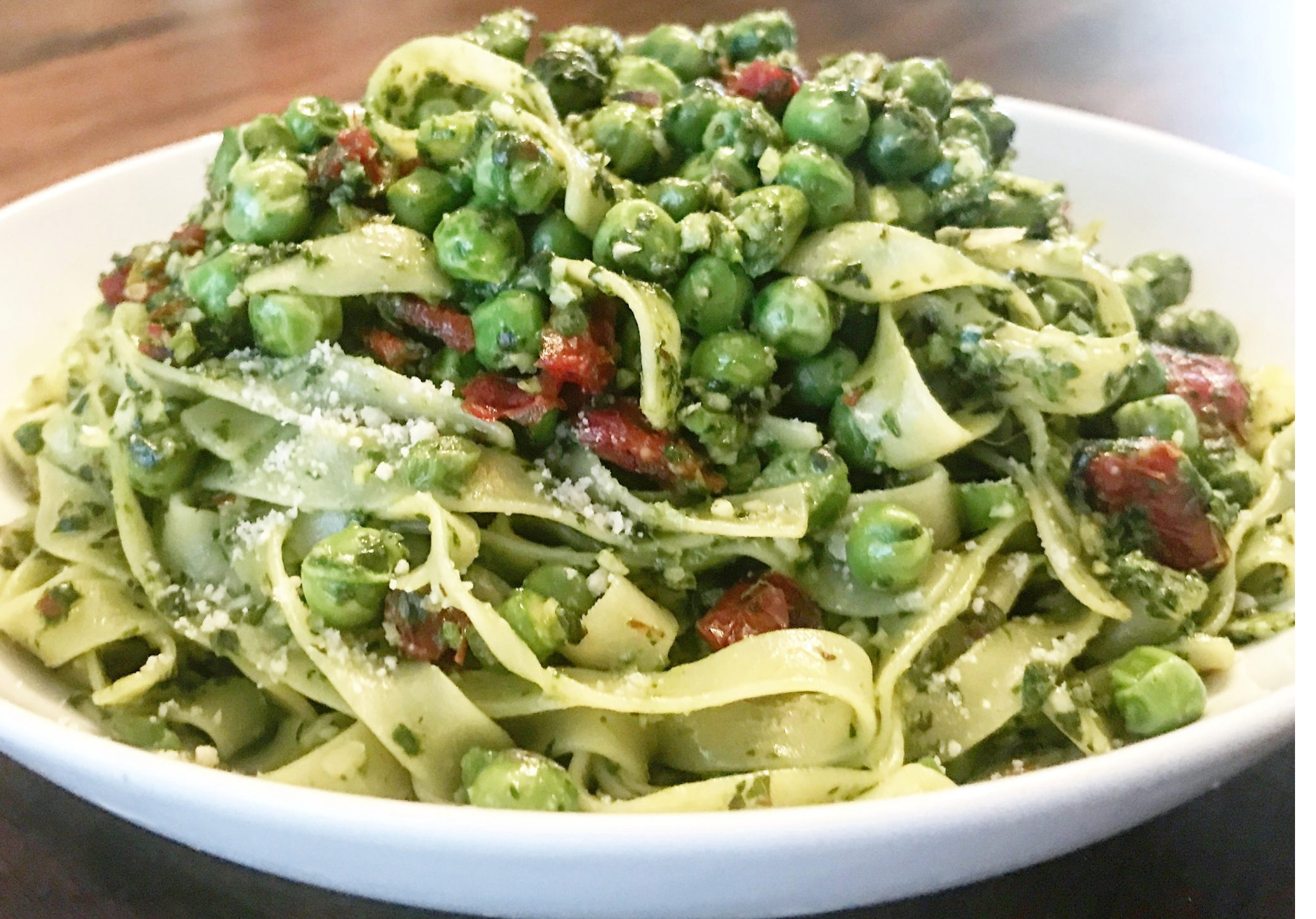 Springtime Pesto Fettuccine - Asparagus, peas, sun-dried tomatoes, and pesto make for a delicious springtime (anytime!) pasta dinner. Dairy-free and Vegan. via @thiswifecooks