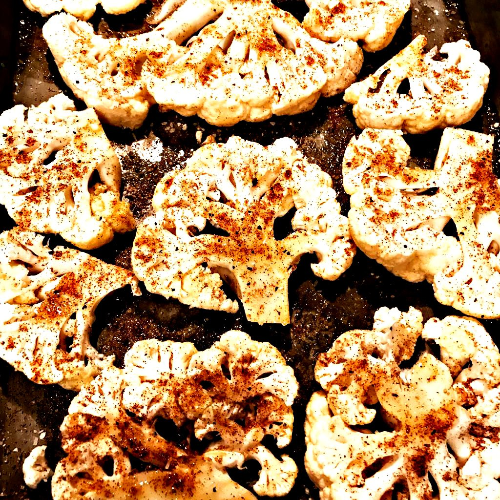 Easy Cauliflower Steaks - Ready to serve in 30 minutes or less, cauliflower steaks are the perfect go-to weeknight dinner! via @thiswifecooks