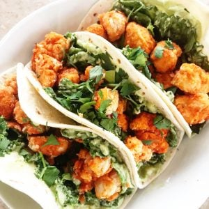 Vegan Twice-Baked Buffalo Cauliflower Tacos recipe | Spicy Buffalo cauliflower with a cool vegan avocado crema on the table in 30-45 minutes.