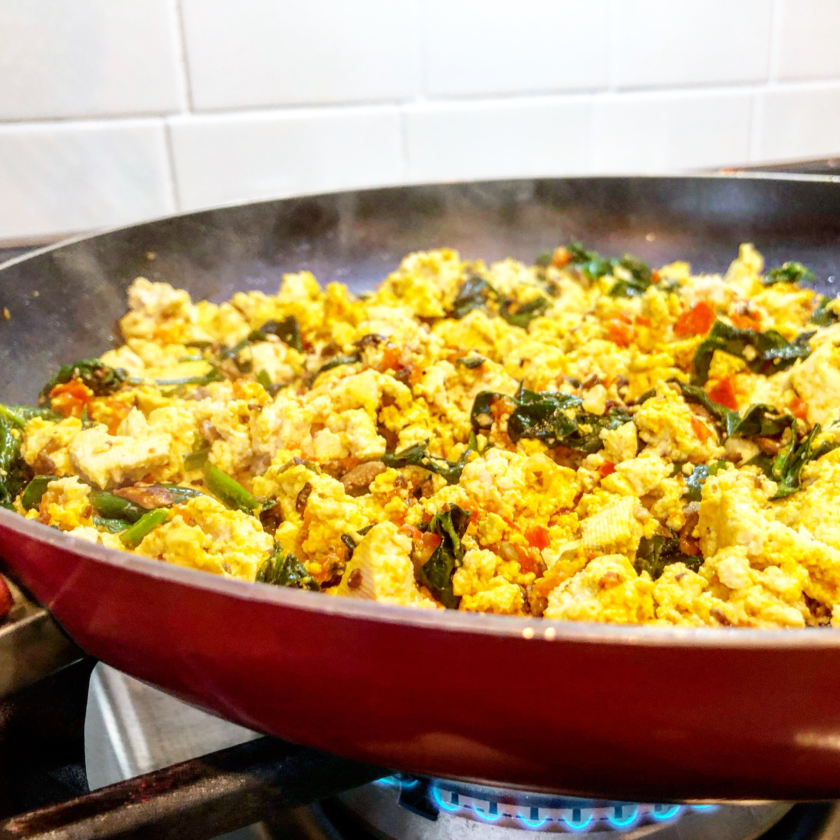 Saturday Morning Tofu Scramble - A quick and easy vegan breakfast tofu scramble the whole family will love! This recipe is very forgiving and easy to customize to what you have on hand. via @thiswifecooks
