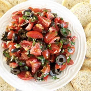 Tomato and Black Olive Bruschetta - Simple and elegant. Perfect for a casual picnic lunch for two or when entertaining guests at home.