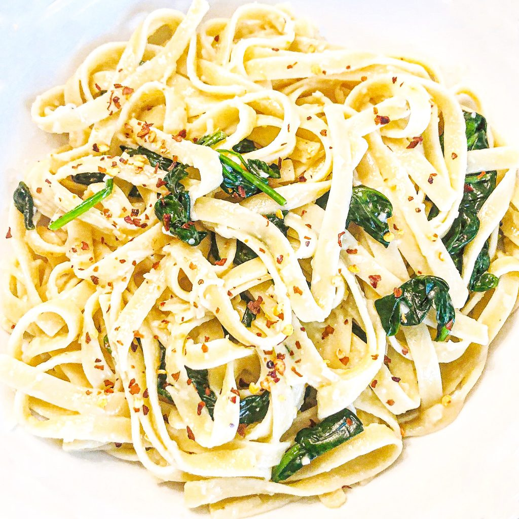 Vegan Spinach Parmesan Fettuccine | Busy days call for quick and easy dinners! This is a favorite go-to meals when we're short on time or just want the simplicity of an easy, no-fuss pasta dinner.