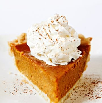 Vegan Thanksgiving Pumpkin Pie - The iconic, quintessential pie of Thanksgiving! Rich, creamy, and loaded with spices of the season. Easy & comforting - a family favorite year after year!