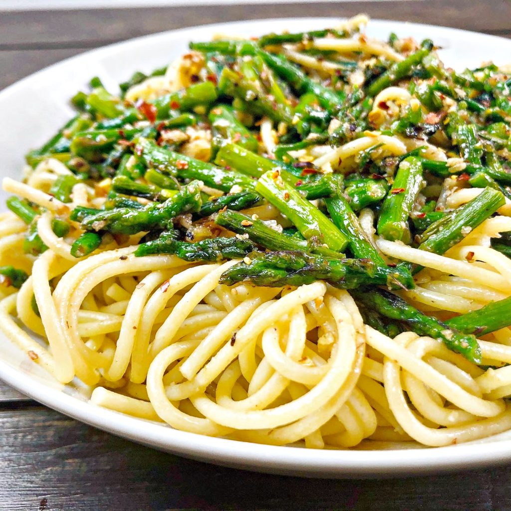 Spaghetti Aglio e Olio with Homemade Pecan Parmesan - The beauty of this dish is in its simplicity! No fussy ingredients here; just fresh asparagus along with a handful of pantry staples is all you need!