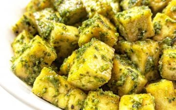 Baked Pesto Tofu - Basil pesto gets tossed with tofu that has been seasoned and roasted with simple spices for a savory dish that is practically effortless.