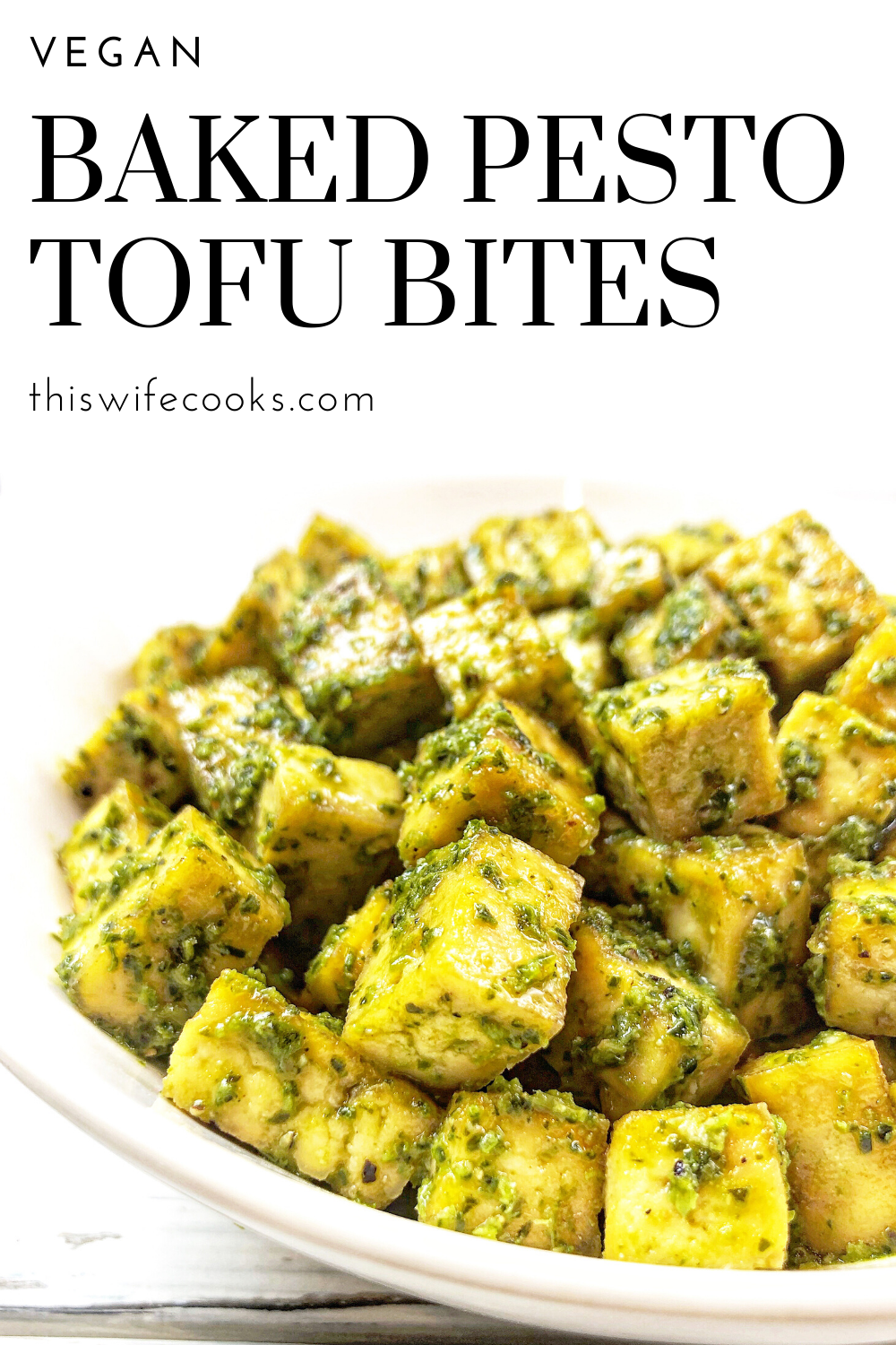 Baked Pesto Tofu - Basil pesto is tossed with tofu that has been seasoned and roasted with simple spices for a savory dish that is practically effortless. via @thiswifecooks