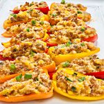 Vegan Sausage and Cheddar Stuffed Mini Peppers - Sweet mini peppers are stuffed with a savory filling of simple ingredients then baked for an easy make-ahead appetizer! These colorful, flavorful crowd-pleasing bites are ready to serve in under 30 minutes! | thiswifecooks.com #veganappetizers #meatlessmonday #thiswifecooks