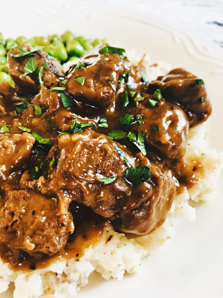 Vegan Beef Tips and Gravy - A hearty and delicious plant-based version of the meat and potatoes classic! #veganbeefrecipes #veganbeeftipsandgravy #veganbeeftipsrecipes #plantbasedbeefrecipes #thiswifecooksrecipes #veganquarantinerecipes #gardeinrecipes #easyvegandinnerrecipes