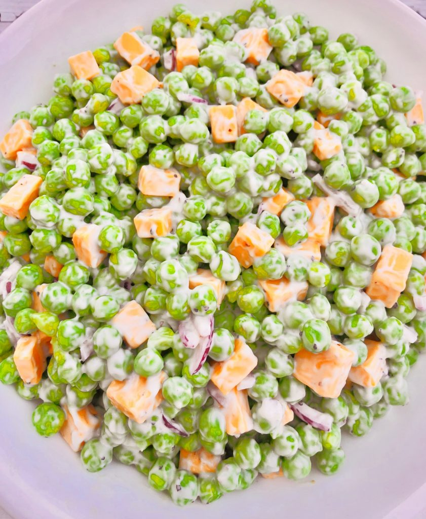Green Pea and Cheddar Salad - A classic side dish made with only a handful of simple plant-based ingredients! #veganpotluck #veganeasterrecipes #plantbasedsidedish #thiswifecooksrecipes #easyveganrecipes #veganbrunchrecipes #veganpeasalad #veganbbqside