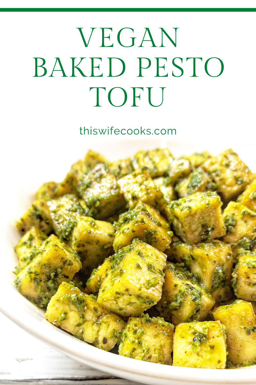 Baked Pesto Tofu - Basil pesto is tossed with tofu that has been seasoned and roasted with simple spices for a savory dish that is practically effortless! #quickandeasyvegan #bakedtofu #pestotofu #thiswifecooksrecipes #easyplantbasedrecipes #highproteinvegan #easyveganrecipes via @thiswifecooks