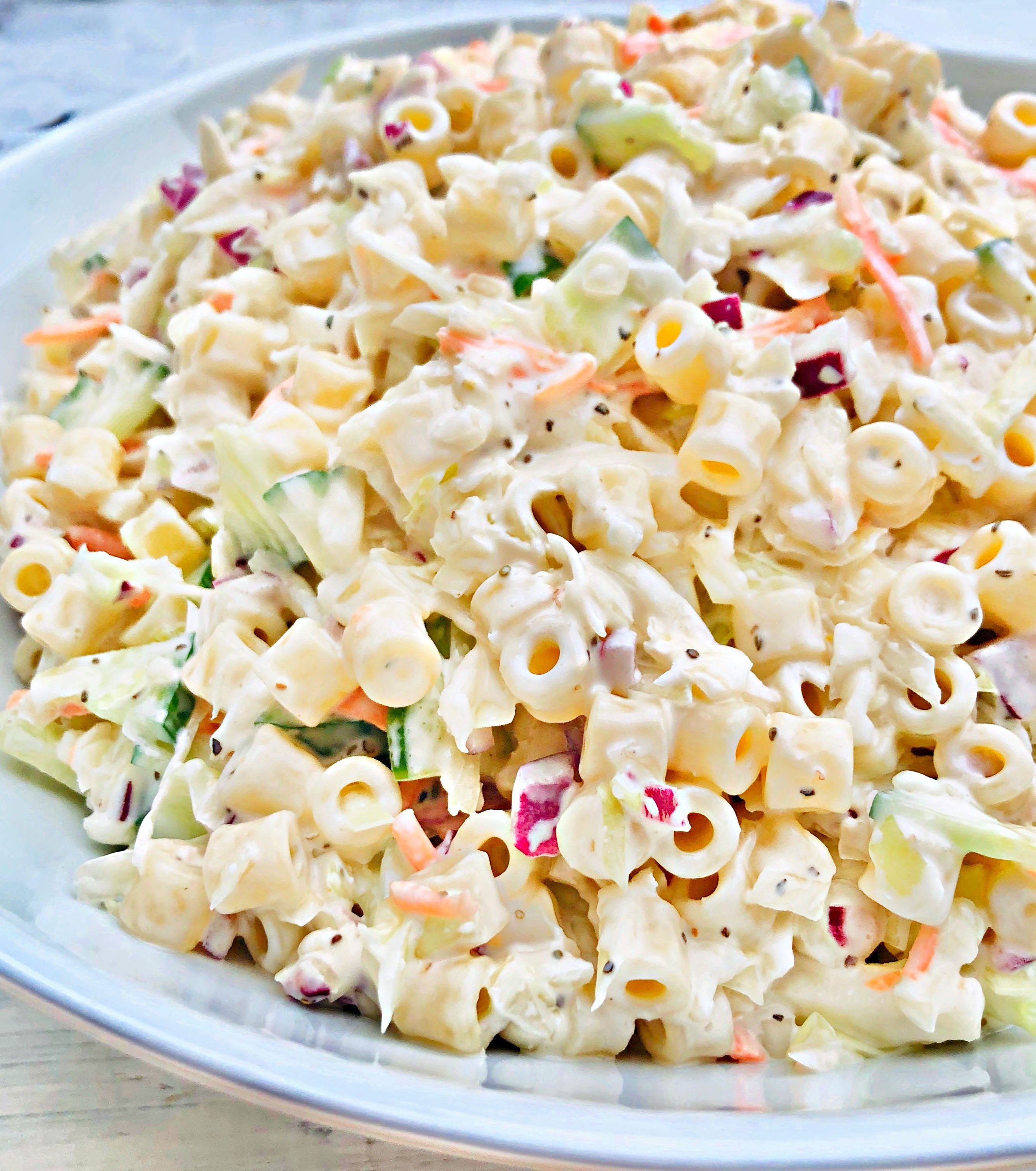 Coleslaw Pasta Salad -An easy, make-ahead side dish recipe perfect for backyard barbecues, potlucks, and holiday gatherings! via @thiswifecooks