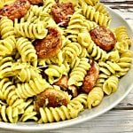 Pesto Pasta with Sausage - A savory and satisfying skillet dinner made with spicy plant-based sausage. Ready to serve in about 30 minutes.