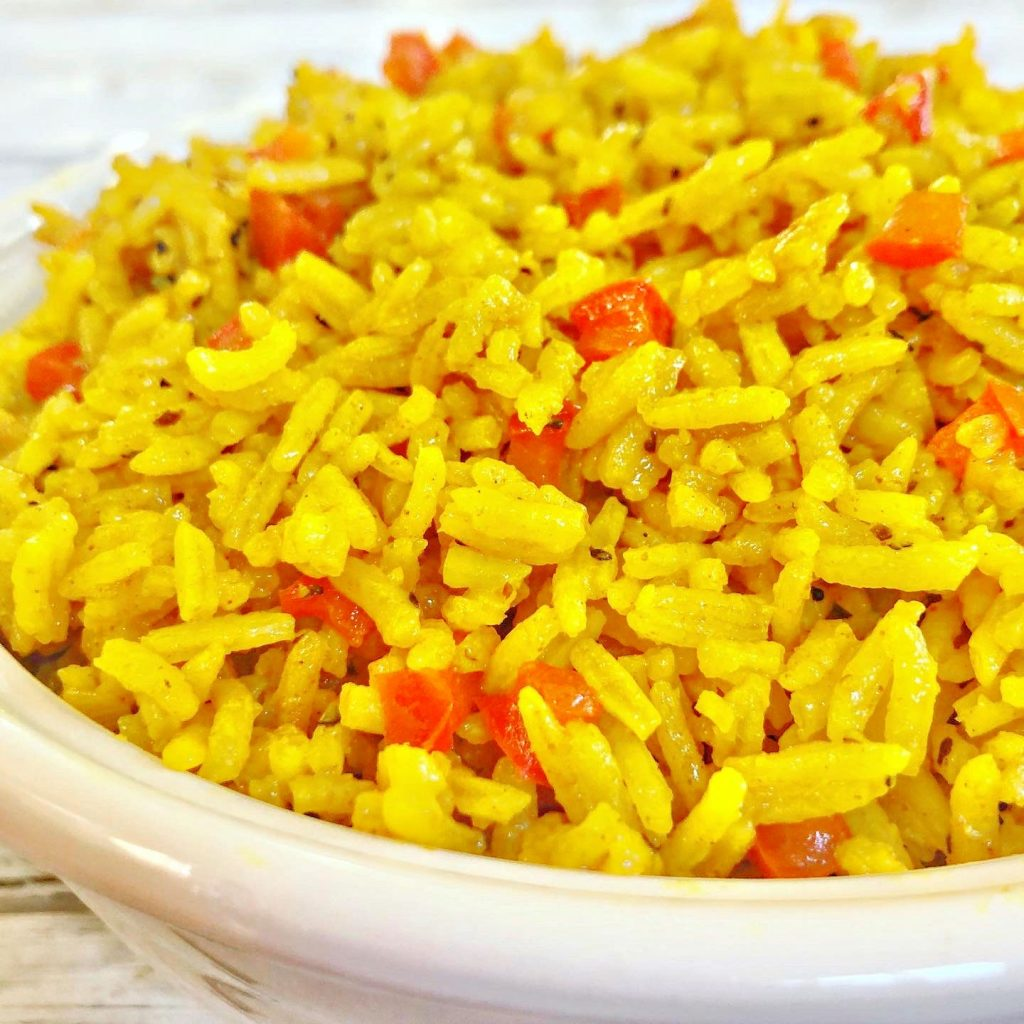 Arroz Amarillo - Spanish for Yellow Rice - is savory turmeric spiced rice that is easy to make with simple ingredients. Ready to serve in under 30 minutes. | thiswifecooks.com