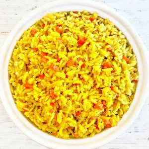 """Yellow Rice ~ Arroz Amarillo - Spanish for """"yellow rice"""" - is savory turmeric spiced rice that is easy to make with simple ingredients. Ready to serve in under 30 minutes."""