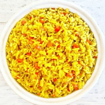 "Yellow Rice ~ Arroz Amarillo - Spanish for ""yellow rice"" - is savory turmeric spiced rice that is easy to make with simple ingredients. Ready to serve in under 30 minutes."