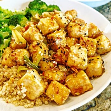 Crispy pan-fried tofu tossed in a sweet garlic and ginger sauce. Super easy to make and ready to serve in less time than it takes to get takeout!