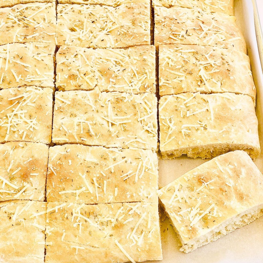 RosemaryParmesan Focaccia Bread - Simple and super easy to make, this versatile flatbread pairs perfectly with all kinds of pasta dishes, soups, and salads. It's also delicious as a sandwich bread!