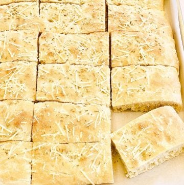 Rosemary Parmesan Focaccia Bread - Simple and super easy to make, this versatile flatbread pairs perfectly with all kinds of pasta dishes, soups, and salads. It's also delicious as a sandwich bread!