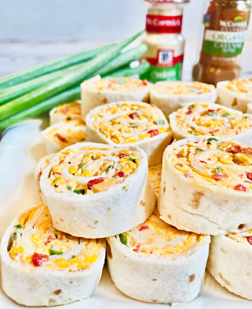 Spicy Pimento Cheese Pinwheels ~ A creamy mixture of dairy-free cheeses, mayonnaise, scallions, jalapeño pepper, pimentos, and spices are rolled into a flour tortilla and sliced into pinwheels. These crowd-pleasing appetizers can also be made ahead of time and refrigerated until ready to serve.
