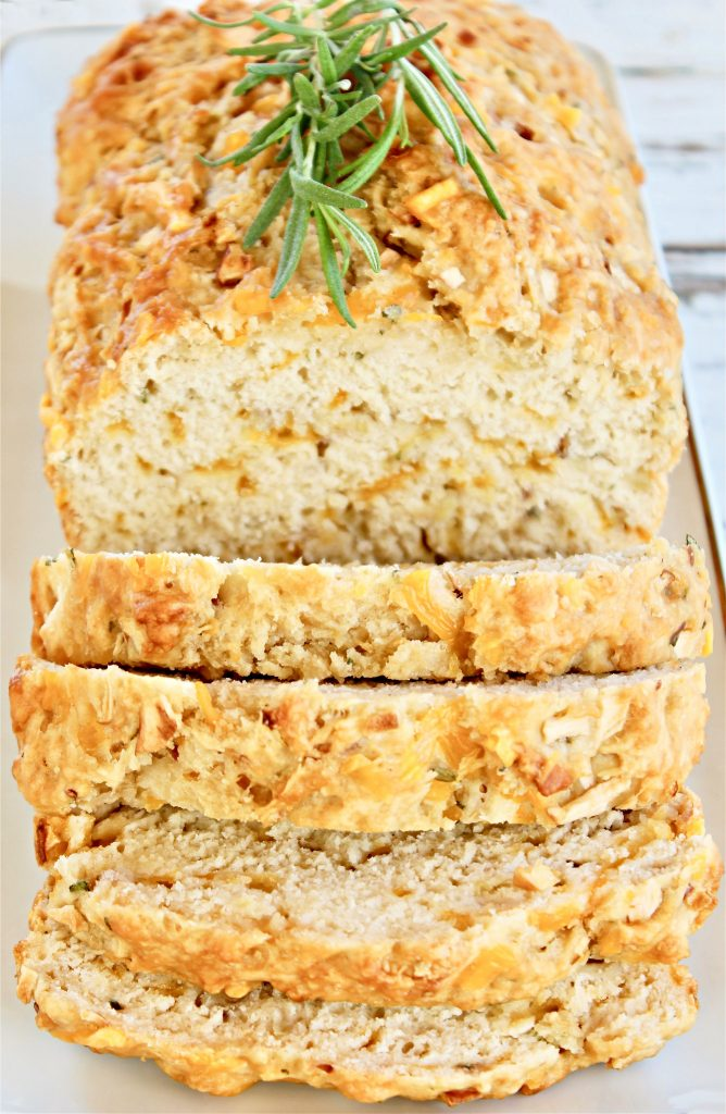 Apple Cheddar Rosemary Bread ~Sweet and savory beer bread with the classic flavor combination of apples, cheddar cheese, and fresh rosemary. Guaranteed to make your house smell like fall!