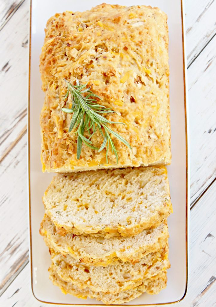Apple Cheddar Rosemary Bread ~ Sweet and savory beer bread with the classic flavor combination of apples, cheddar cheese, and fresh rosemary. Guaranteed to make your house smell like fall!