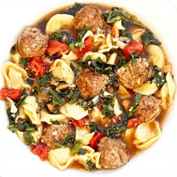 Meatball Tortellini Soup ~Veggie meatballs and dairy-free cheese-filled tortellini served in a savory and meatless beef-style broth with carrots, onion, garlic, spinach, tomatoes, and seasonings. This is a simple yet robust and flavorful soup that is quick and easy to make in 30 minutes or less!