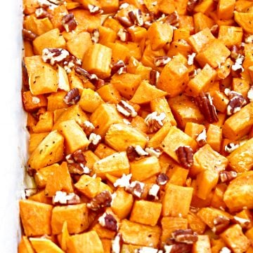 Roasted Sweet Potatoes ~ Bite-site chunks of sweet potatoes roasted with olive oil and maple syrup are lightly crisp on the outside and soft on the inside. Sea salt, ground black pepper, and toasted pecans add savory balance to this naturally sweet fall seasonal favorite. Ready to serve in under an hour and make an easy and flavorful side dish for Thanksgiving or Christmas dinner.