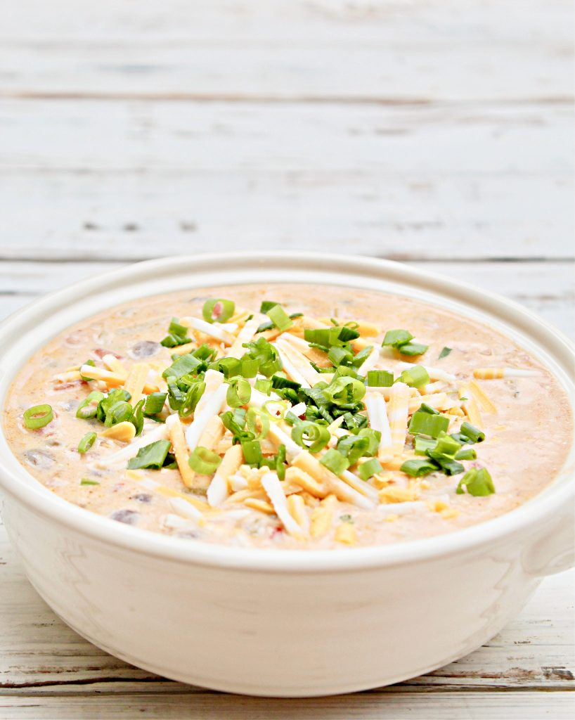 Creamy Black Bean Taco Soup ~Easy and dairy-free cheesy weeknight dinner packed with black beans, onions, tomatoes, green chiles, and taco seasonings. If you like loaded queso, you're going to love this taco soup!