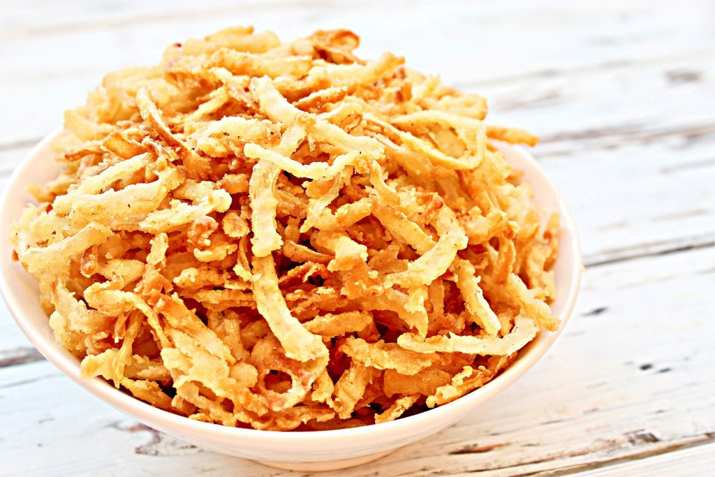 French Fried Onions ~ Super crispy, loaded with flavor, and easy to make. Fried onions are great for topping burgers, soups, salads, and casseroles. Once you see how quick and simple it is to make your own - and taste the difference! - you'll never go back to the canned stuff again.