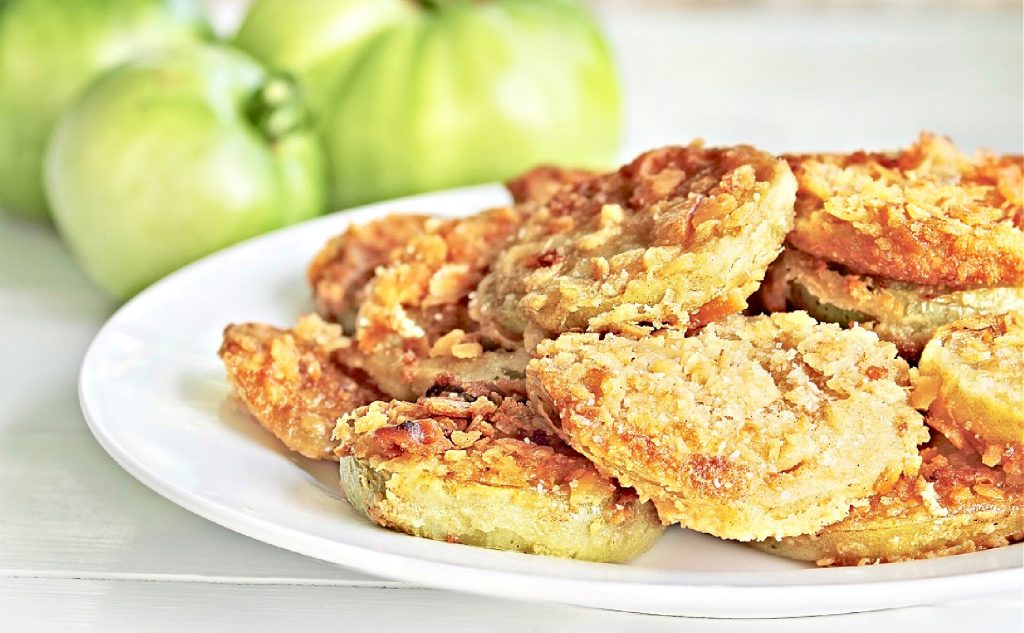 Fried Green Tomatoes ~Batter-coated and fried until soft inside and perfectly crispy outside. Cajun seasoning adds a Louisiana-style kick!