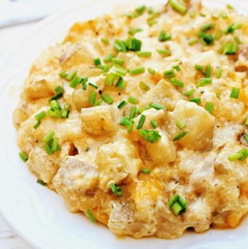 Crockpot Cheesy Potatoes are rich, creamy, and ultra cheesy! Made with fresh Russett potatoes in a savory homemade dairy-free cheese sauce.