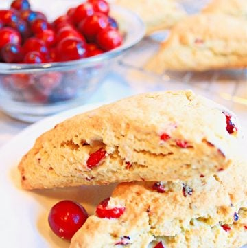 Cranberry Scones ~ Classic scones infused with the festive flavor of cranberries are easy to make and add a pretty pop of color to any holiday breakfast or brunch!