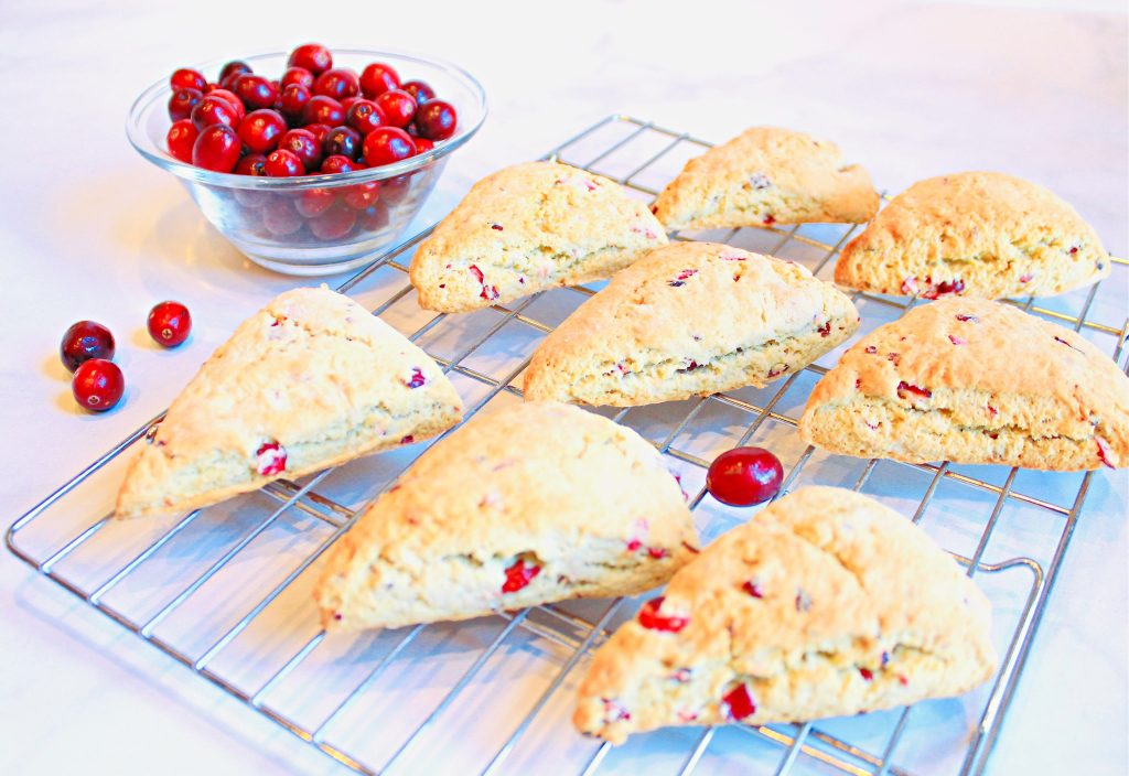 Cranberry Scones ~Classic scones infused with the festive flavor of cranberries are easy to make and add a pretty pop of color to any holiday breakfast or brunch!