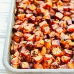 Cubed sweet potatoes tossed with red onion, smoked paprika, and simple seasonings then roasted in the oven for about 45 minutes. This sheet pan recipe is super easy and perfect for brunch or breakfast-for-dinner night!