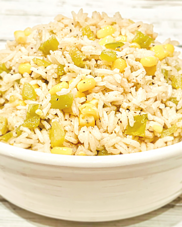 Corn and Green Chile Rice ~ The perfect accompaniment to your favorite Mexican dishes! This easy to make and budget-friendly side dish is ready to serve in just 30 minutes!