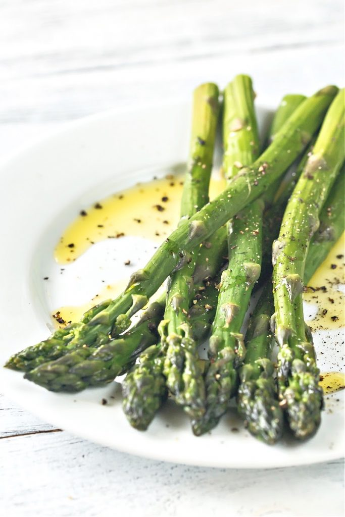 Fresh asparagus spears sauteed with olive oil, butter, garlic, and simple seasonings. Light, fresh, and easy. Ready to serve in just 10-minutes.
