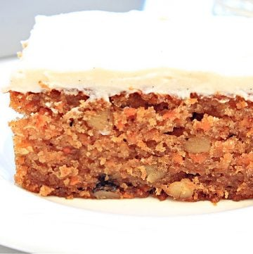 Vegan Carrot Cake ~ This light and tender cake is perfectly sweet, loaded with freshly grated carrots, studded with walnuts, and infused with warm spices of cinnamon and nutmeg in every bite!