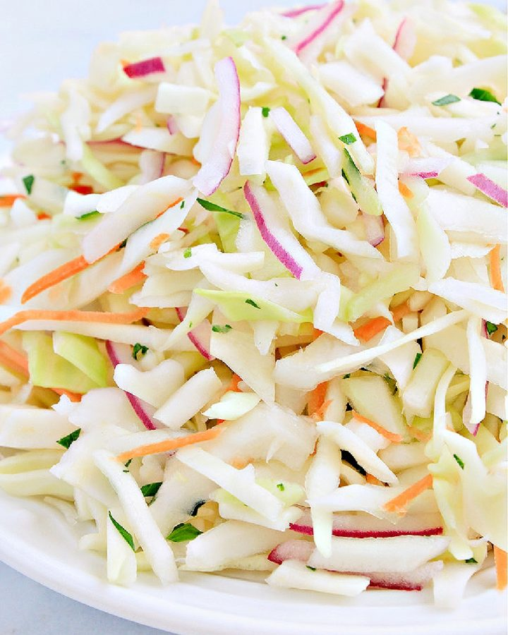 Mexican coleslaw with cabbage, red onion, jalapeno, cilantro, and lime.