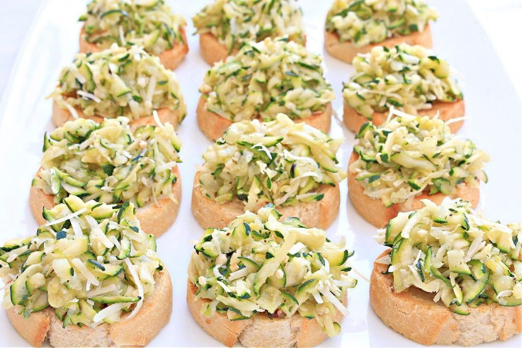 Zucchini Crostini ~ Toasted baguette with an easy bruschetta of grated zucchini, vegan parmesan, garlic and onion, and simple seasonings. Perfect for the warmer months as an appetizer or light meal served outdoors.