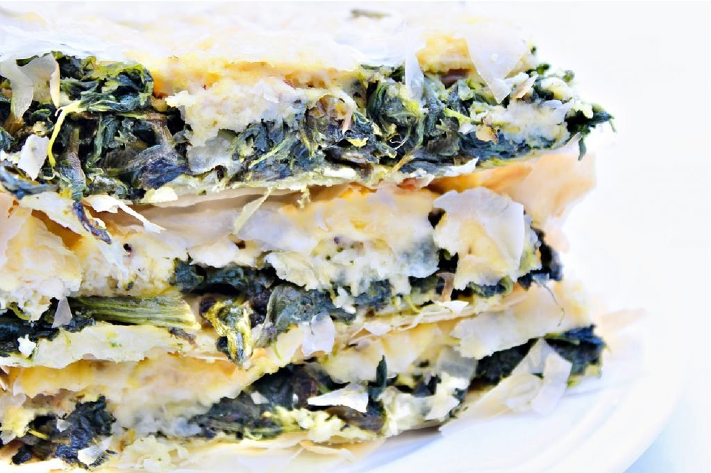 Vegan Spanakopita ~ A savory and aromatic Greek-style main dish or hearty appetizer packed with spinach and vegan feta cheese between layers of crispy phyllo dough.