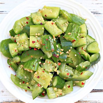 smashed cucumber salad in bowl - top down view