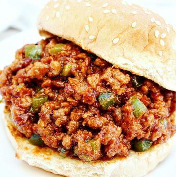 Close-up of sloppy joe sandwich on burger bun.