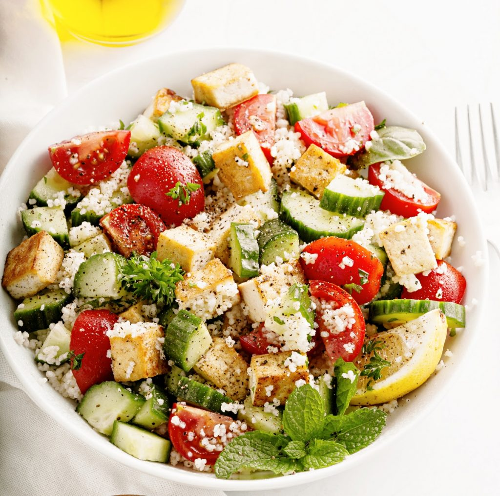 herbed couscous and tofu salad in white bowl