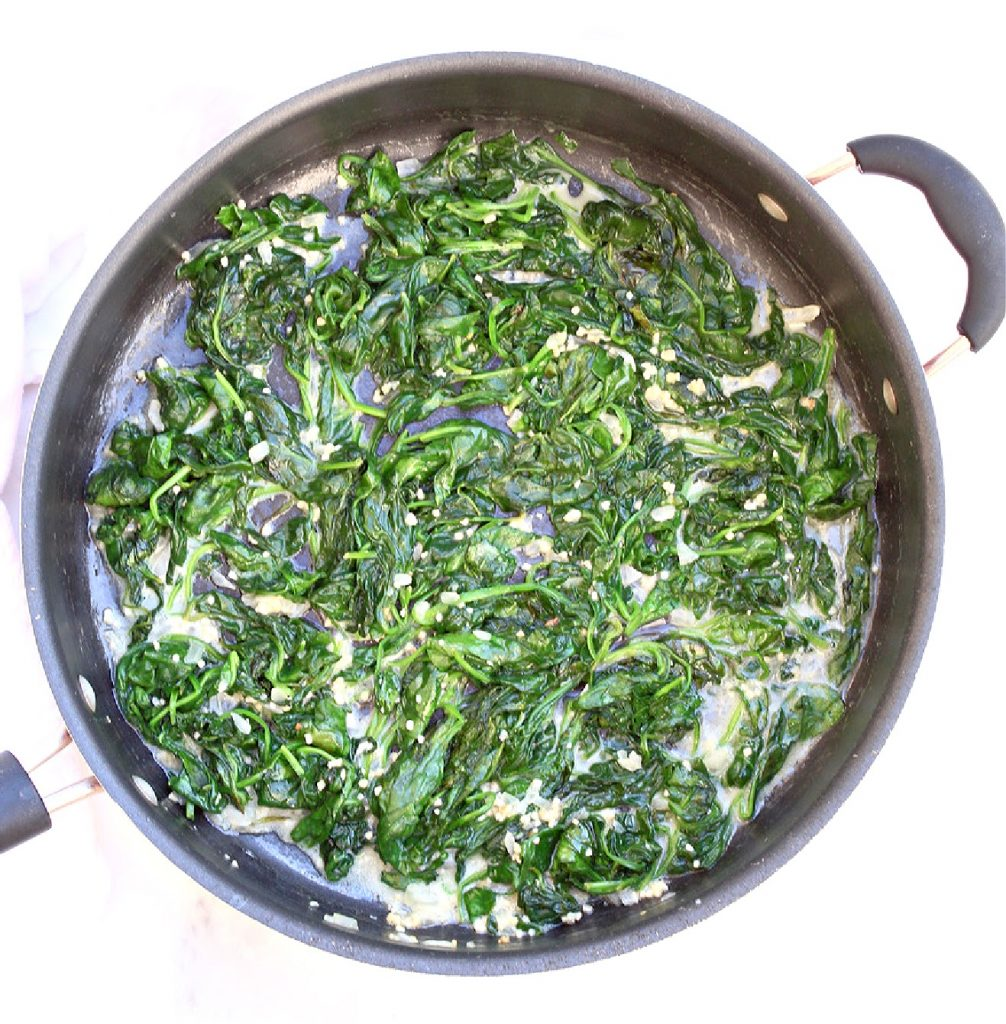 Spinach, melted butter, onion, and garlic in pan.