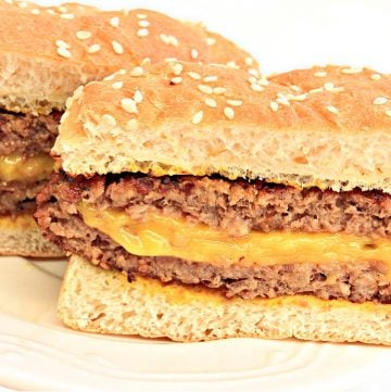 Two halves of burger on bun.