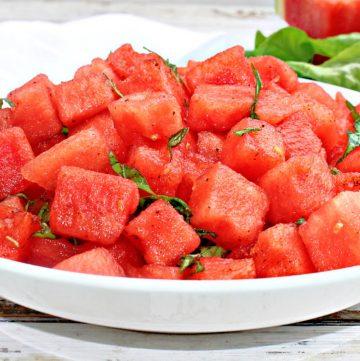 Watermelon Basil Salad is light, refreshing, and simple to make! Chili powder, lemon, & salt counterbalance the sweetness of the watermelon.