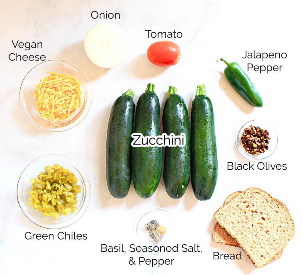 Baked Zucchini Boats ~ These garden-fresh zucchini stuffed with veggies serve 4 as a light main course or 8 as a side dish.