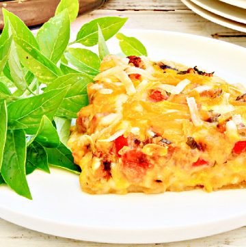Tomato and Basil Quiche ~ An easy and dairy-free quiche made with JUST Egg. Perfect for brunch or dinner! Serve with roasted potatoes or a side salad and you're all set!
