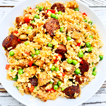Plant-based chicken and vegan Mexican-style chorizo sausage with saffron-infused rice and fresh veggies. A hearty and flavorful Spanish-inspired dinner your family will love!